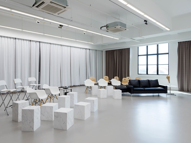 black and white seminar venue in singapore with lot of chairs and large windows