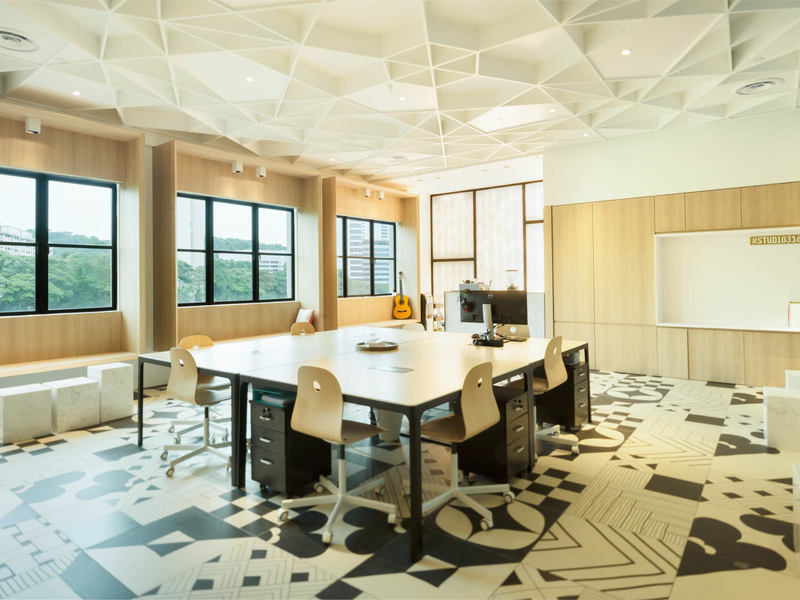 networking event space in singapore with patterned floors and several big windows