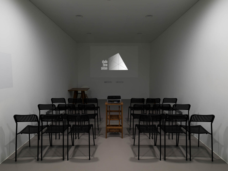 singapore small seminar room with projector screen and black chairs