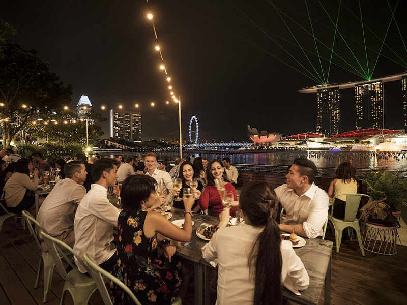 team celebrate special moment together with city view at night