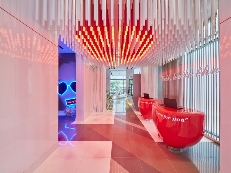fungky hotel lobby with red and white interior