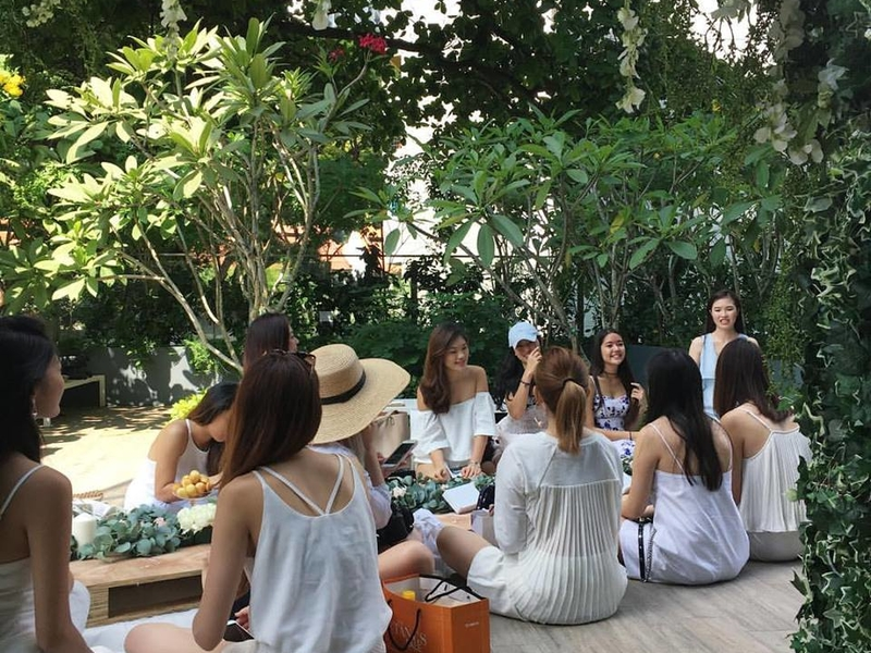 girls gathering together with white themes