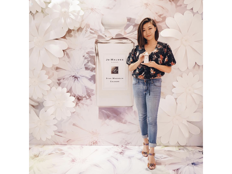 guest poses with product in launch event