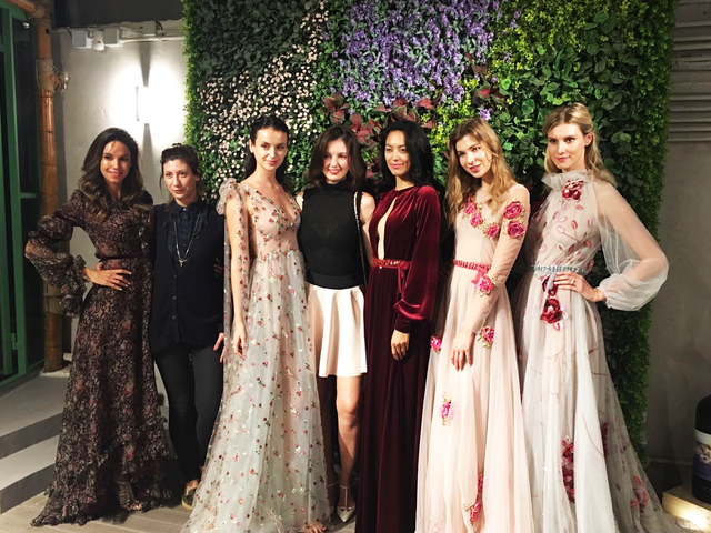 models posing in launch party with garden theme
