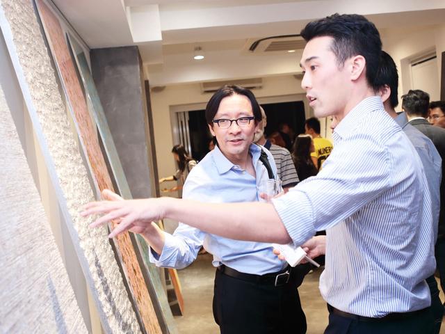 guide explaining artwork in art exhibition