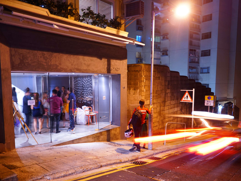 partygoers mingle in front of event venue