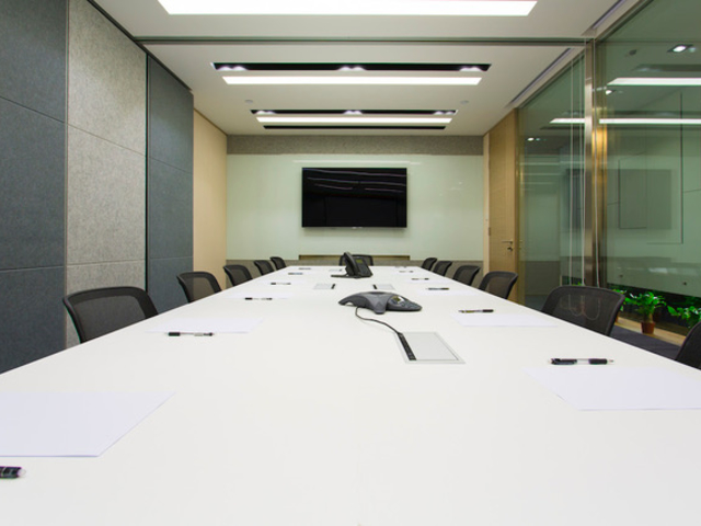 board meeting room with tv screen on the wall