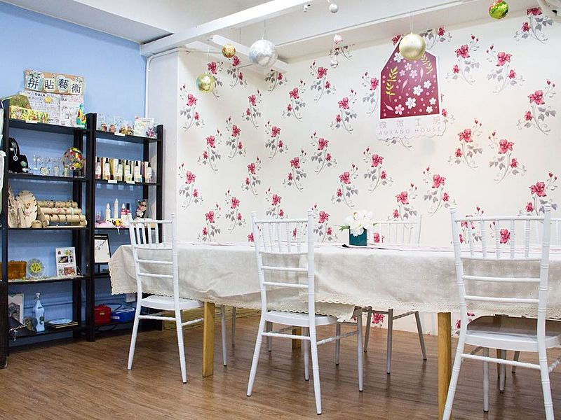 dining area with flower wallpaper and hanging decorations on the ceiling