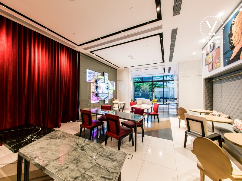 restaurant with red curtain and high ceiling
