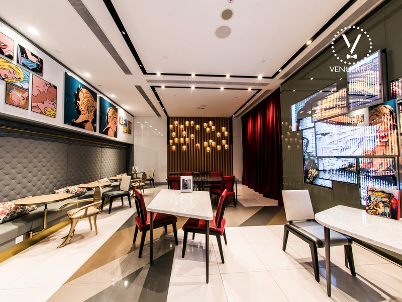 minimalist restaurant with high ceiling and painting decoration