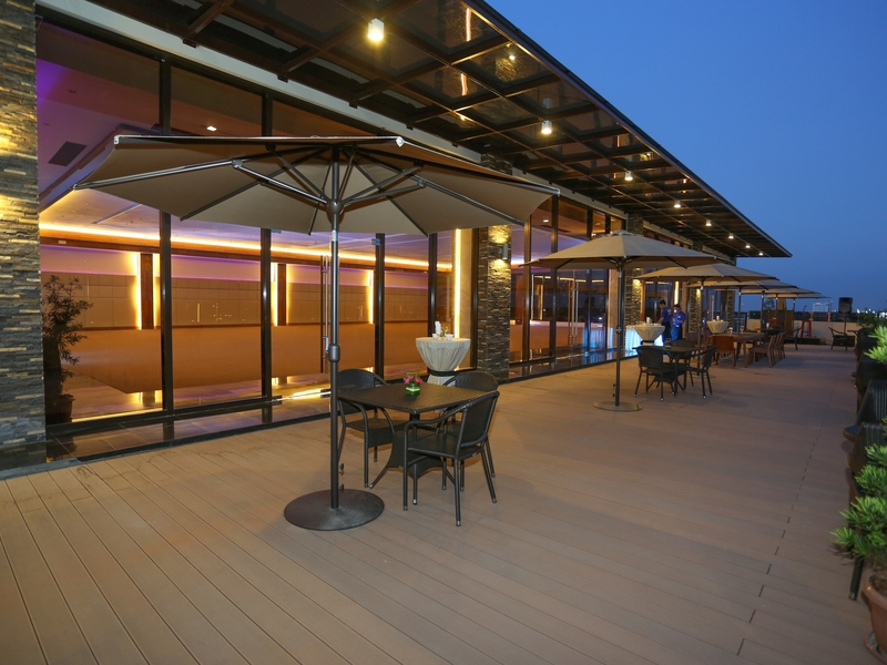 hotel's rooftop area with panoramic view of the city