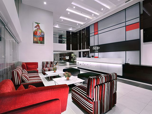 hotel neo penang lobby with red couch