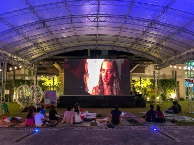 audience gathered for outdoor movie screening