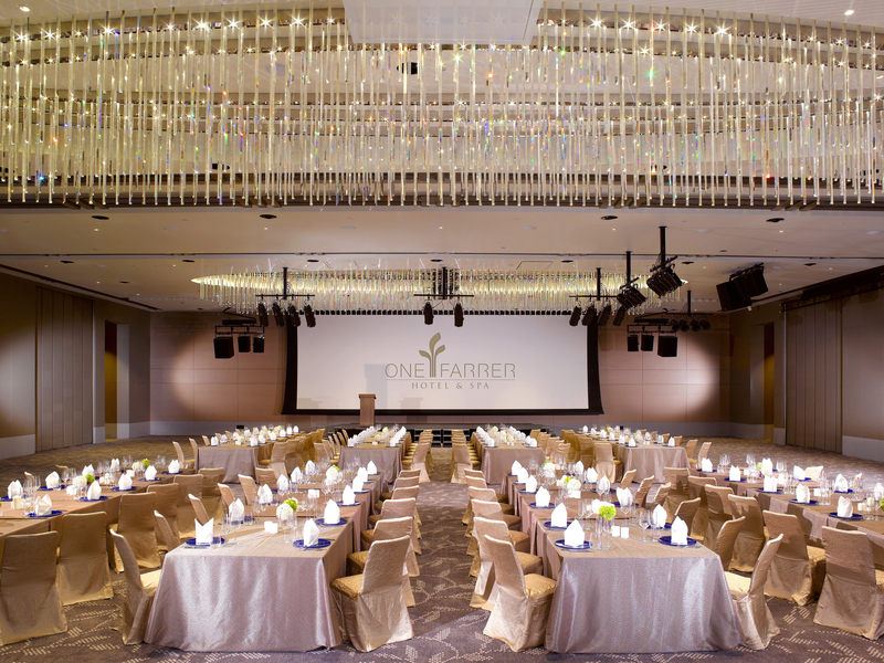 ballroom with high ceiling and gala dinner set up and stage