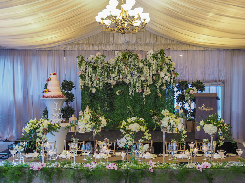 dessert table with green and flower decoration