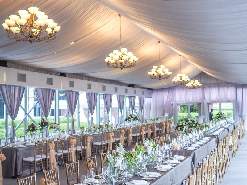 minimalist but elegant wedding decoration with long dining table and big hanging lamp