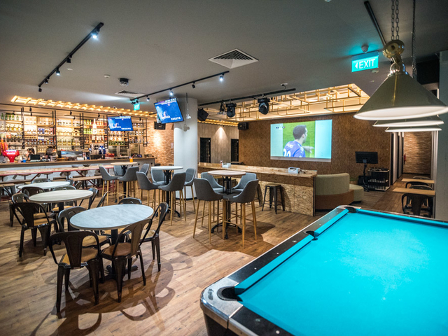 cafe with pool table and large screen for watch match