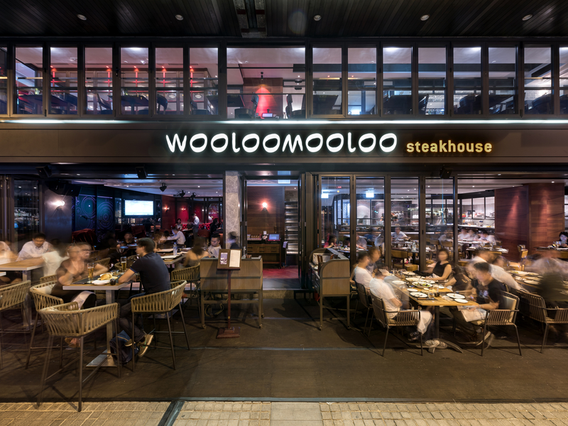 customers dining at wooloomooloo steakhouse outdoor space