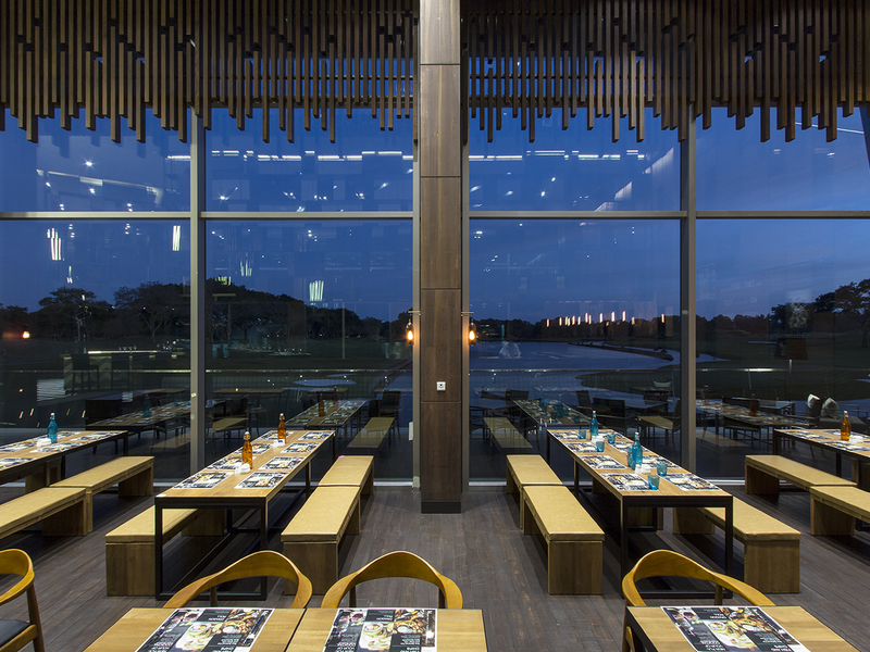 singapore restaurant with large fixed windows and golf view