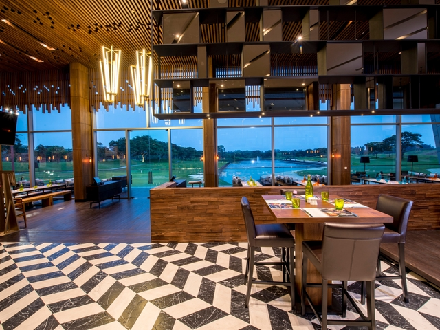 patterned floors restaurant in singapore with high ceiling and golf view