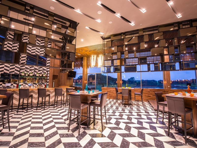 restaurant in singapore with bar and patterned floors