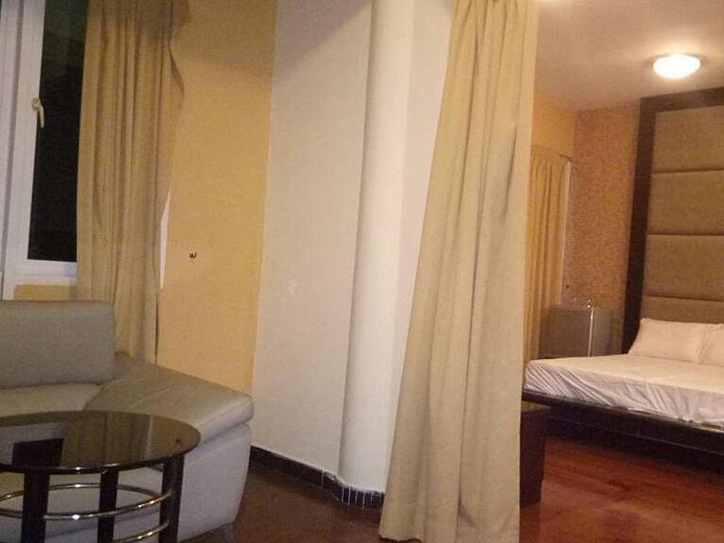 minimalist bedroom with living room inside