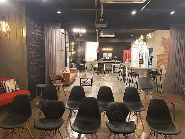 small seminar set up chairs in high ceiling room