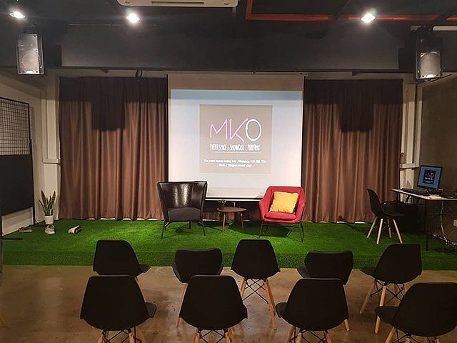 seminar setup with giant screen and stage setup