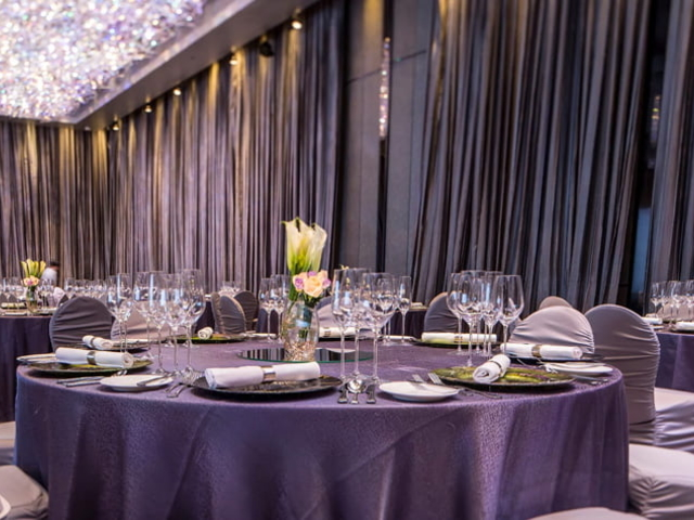 round table setup with curtains and chandelier