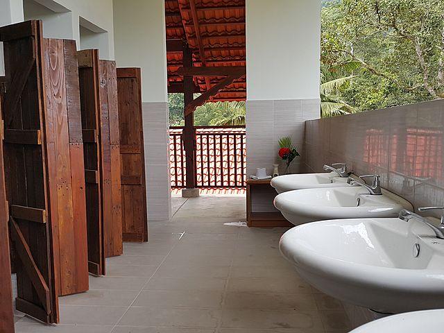 semi-outdoor bathroom in villa pahang with wooden doors