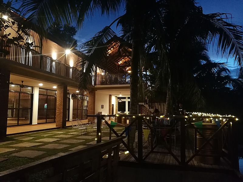 large villa in pahang with a lot of coconut trees
