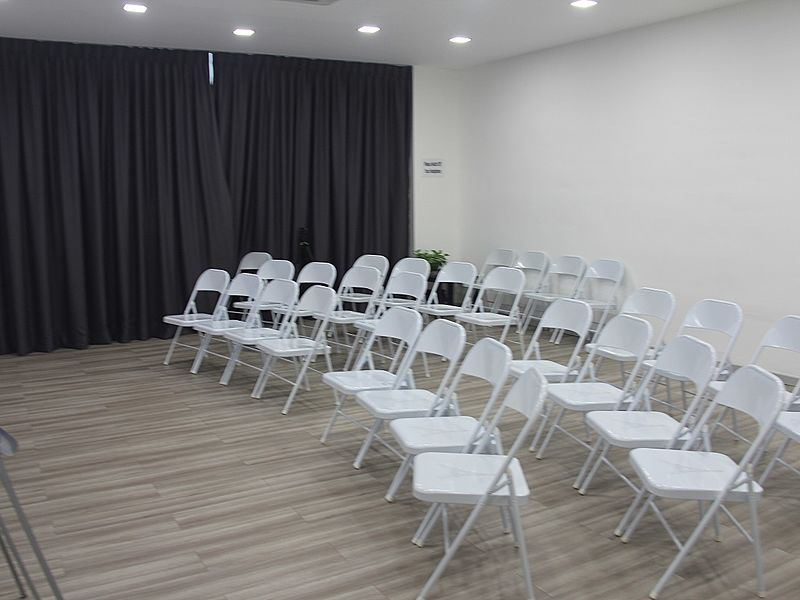 room with theatre seating setup for coporate training