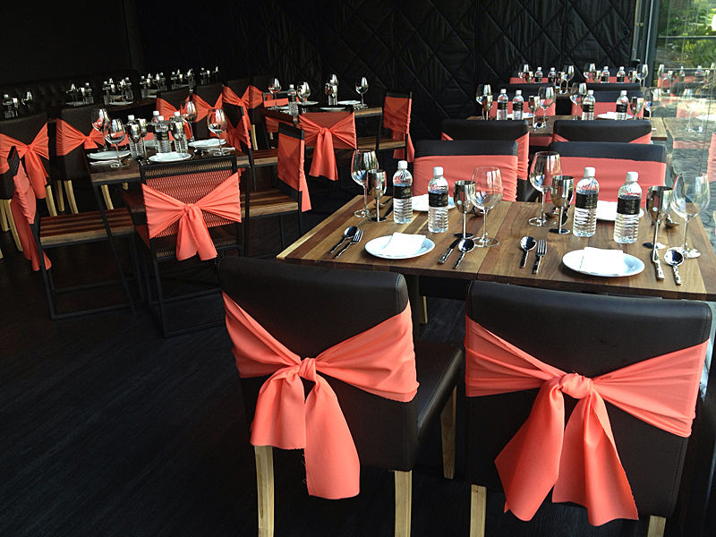dining area with ribbon on the chair