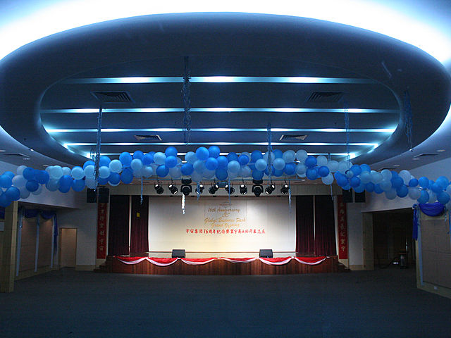 convention centre with stage and high ceiling