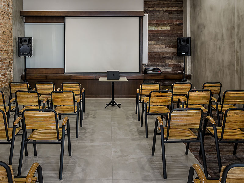 small minimalist seminar room with projector screen malacca