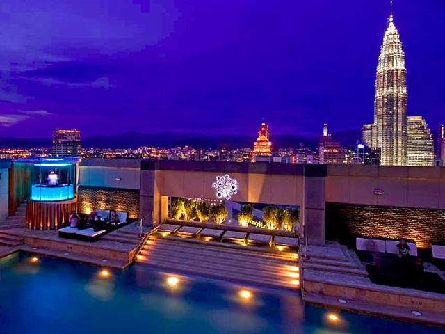 outdoor swimming pool in the rooftop with petronas twin views