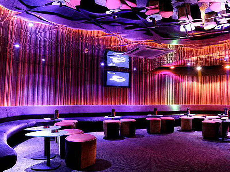 bar lounge area in kuala lumpur with mirror ceiling and long couch