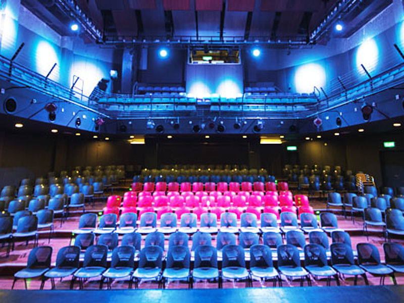 medium size theatre in selangor with black and red audience chairs