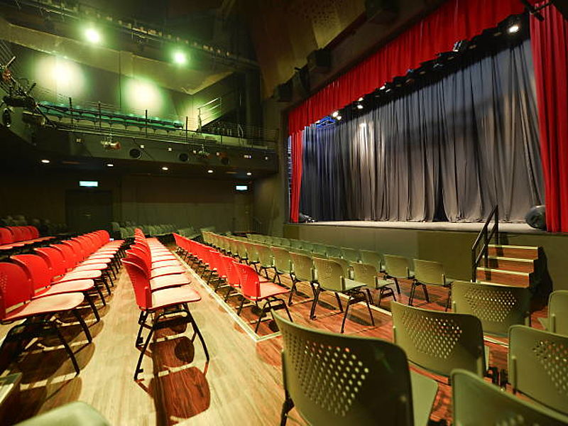 high ceiling theatre room in selangor with black drape stage