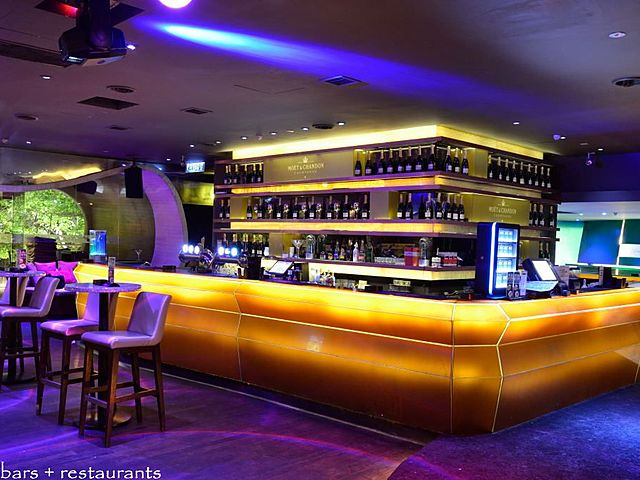 bar area of zouk with lot of alcohol drinks options