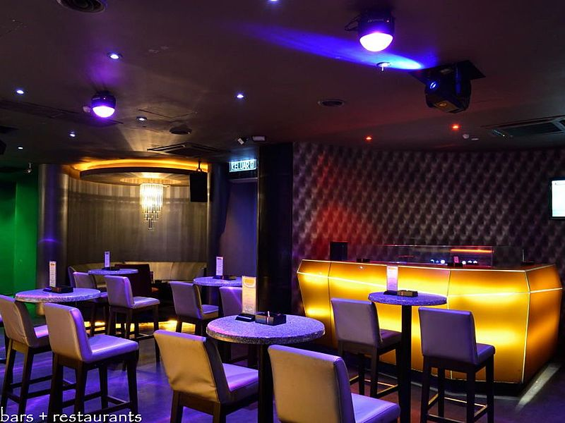 bar and restaurant area with purple lighting
