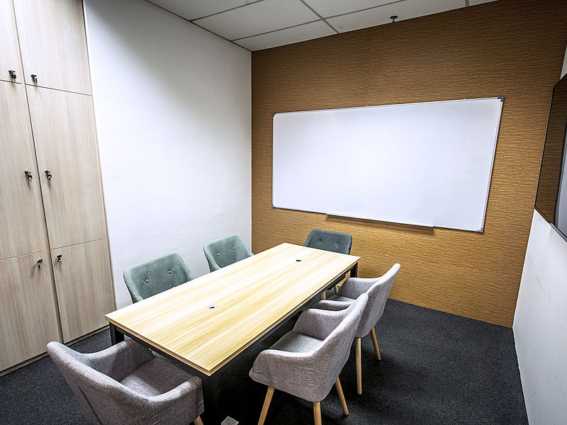 small meeting room with white board for six capacity