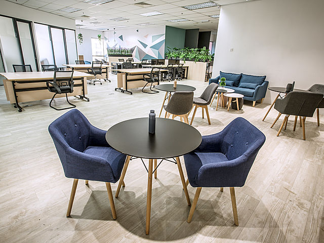round table and two chairs in office main area