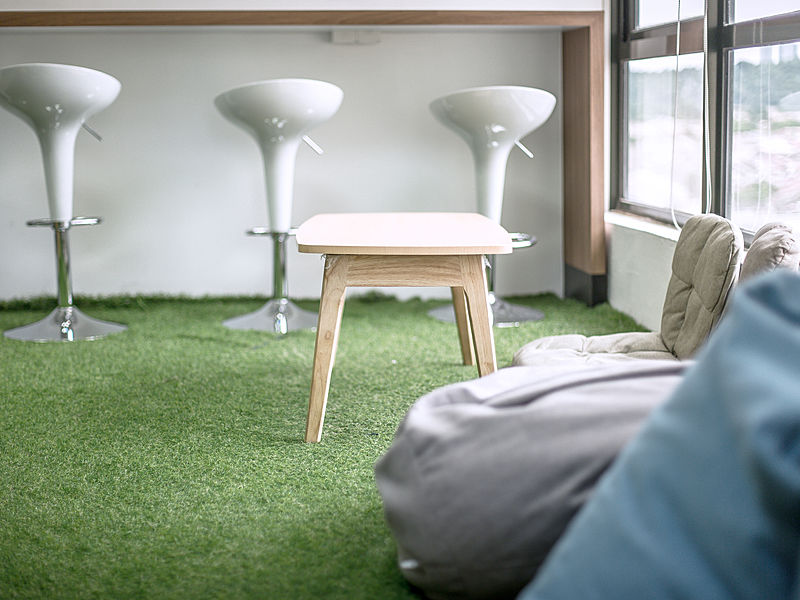 relax place in the office beside big windows with beanbag and short table