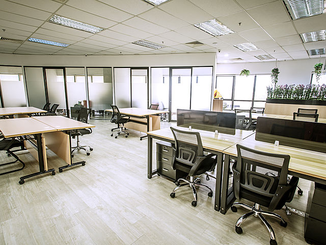 office room with big windows with high ceiling