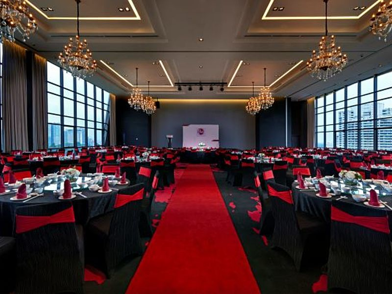 glass wall ballroom in kuala lumpur with banquet seating and red carpet