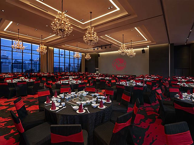 event ballroom with black-red banquet seating and giant screen in kuala lumpur