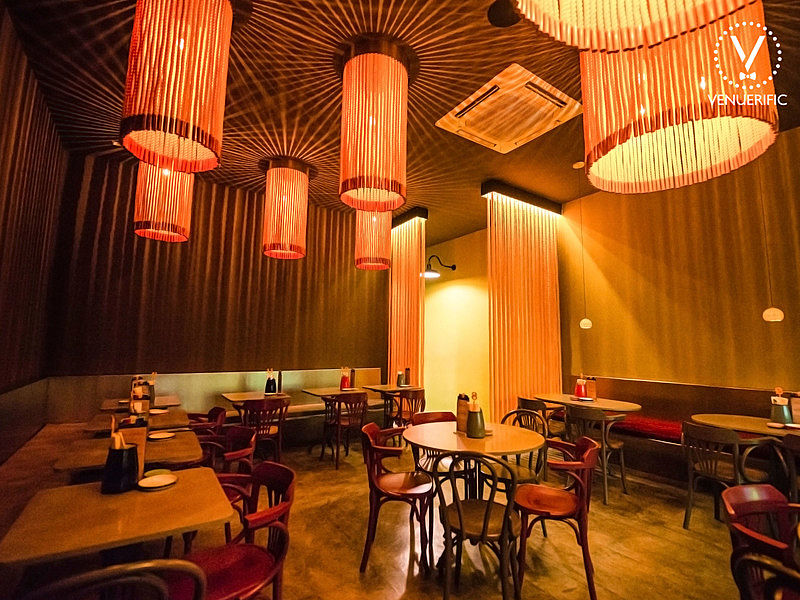 private dining room area from alittle tashi with couch tables