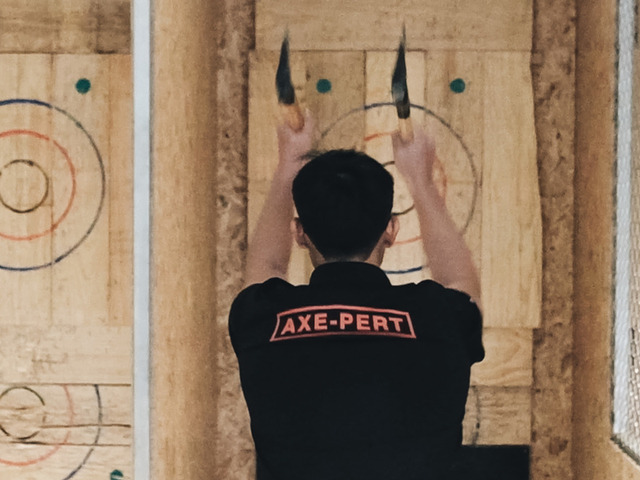 a man is playing axe throwing for refreshing