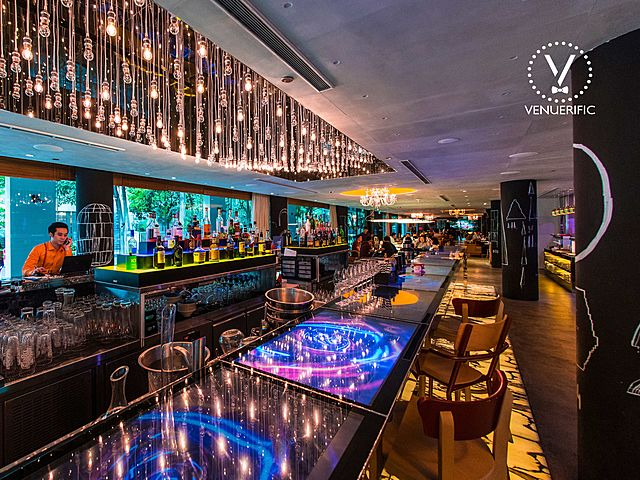 level I indoor bar area with lot of chandeliers